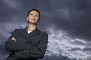 Self confident woman against a stormy cloud
